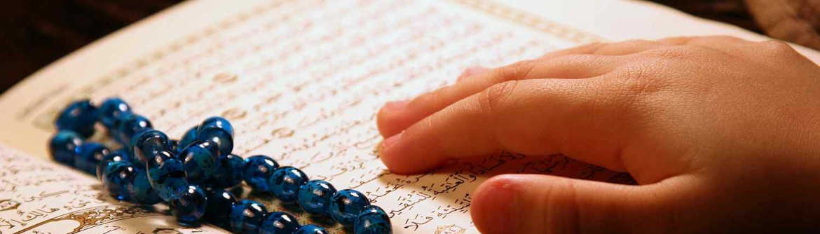 Reading Quran with hands